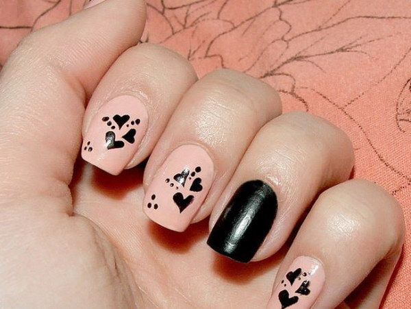 Pink and Black Heart Nail Design.