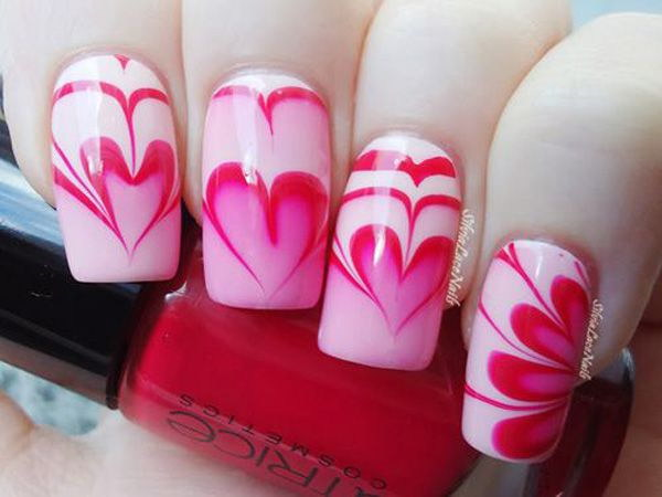 A Heart and Flower Shaped Marble Nail Art Design.