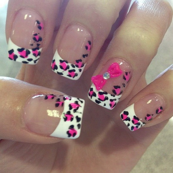 French tip nail art with pink and black leopard prints. The studded pink  bow looks - 50 Stylish Leopard And Cheetah Nail Designs - For Creative Juice