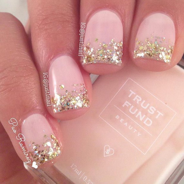 Gold Glitter Tips French Nail Design.