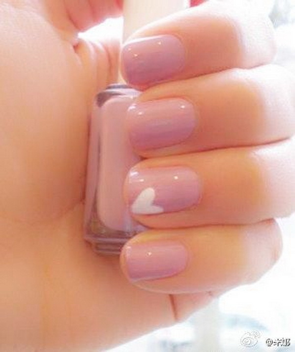 Pink Nail Design with a White Heart Accent.