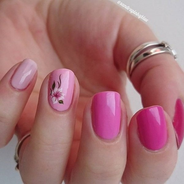 Gradient Pink Nails with a Small Flower on Top.
