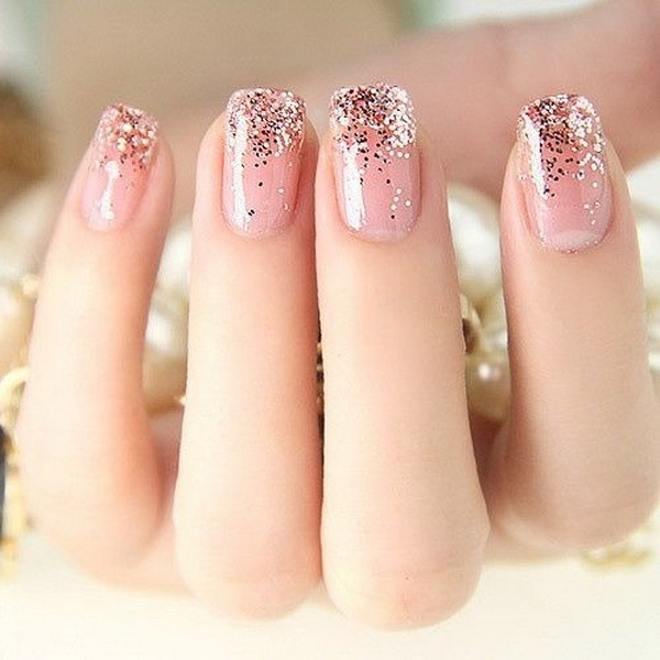 Pink Nails with Gold Glitters.