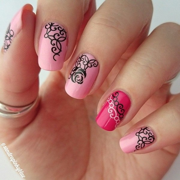 Baby Pink and Salmon Pink Nails with Black Colored Details on Top.