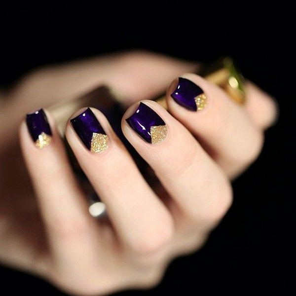 Dark Purple Nails with Gold Triangles.