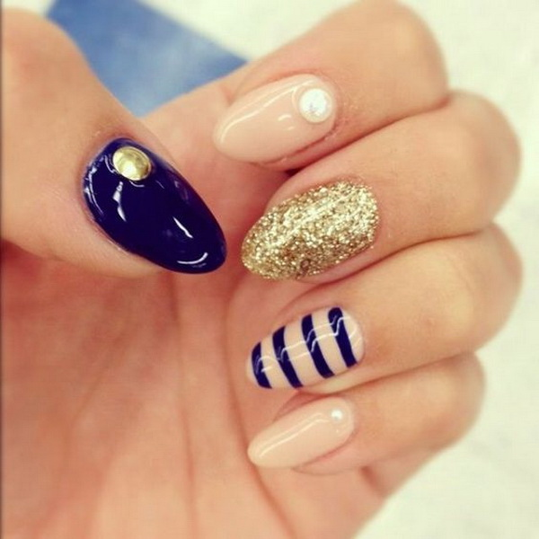 Navy and Nude Almond Nail Design with Glitter and Strips Details.