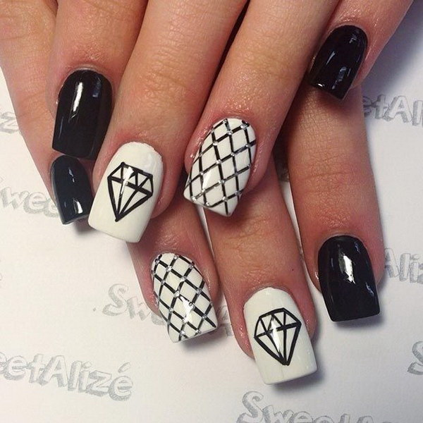 Black and White Nail Design with Diamonds.