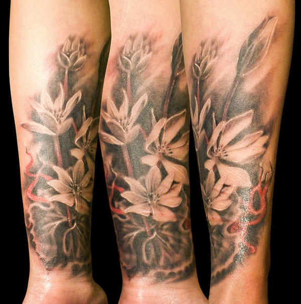 Floral Forearm Tattoo for Men or Women.What a cool tattoo design idea!  Love it very much! This will be my next tattoo design. via https://forcreativejuice.com/awesome-forearm-tattoo-designs/