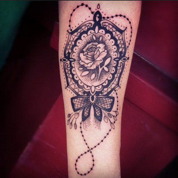 Medallion, Lace and Rose Arm Tattoo.