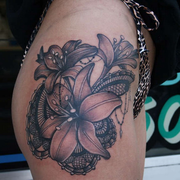 Beautiful Lily With Unusual Lace Tattoo On Hip. via forcreativejuice.com