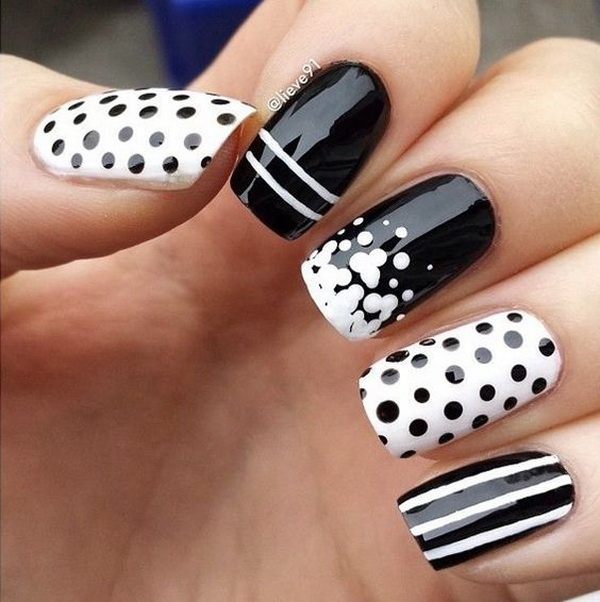Black and White Nail Art with Polka Dots and Strips. (via forcreativejuice.com)