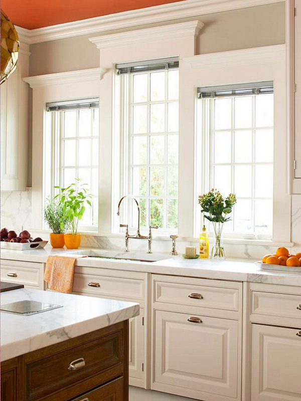 White kitchen with vibrant orange ceiling white-painted cabinets and trim. More via https://forcreativejuice.com/elegant-white-kitchen-interior-designs/