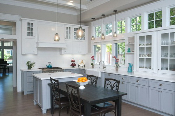 Traditional eat-in kitchen with gray cabinets, white backsplash and an island. More via https://forcreativejuice.com/elegant-white-kitchen-interior-designs/