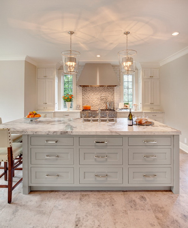 White cabinetry, sage green painted island with marble countertops. Love the two modern and stylish lamps above. More via https://forcreativejuice.com/elegant-white-kitchen-interior-designs/