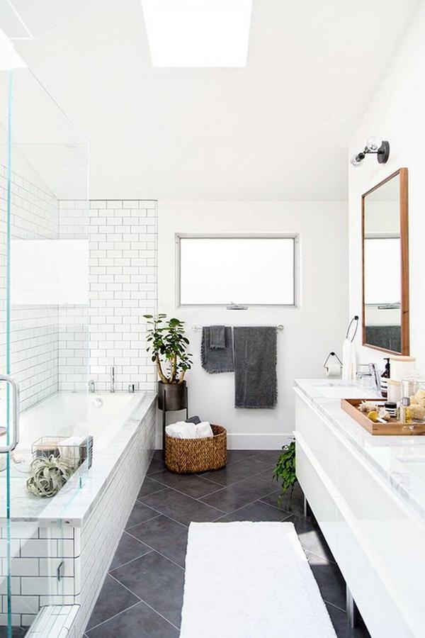 Modern bathroom design with subway tiles, glass door...