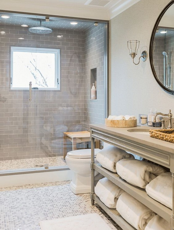 Custom bathroom using ice grey glass subway tile shower tile.
