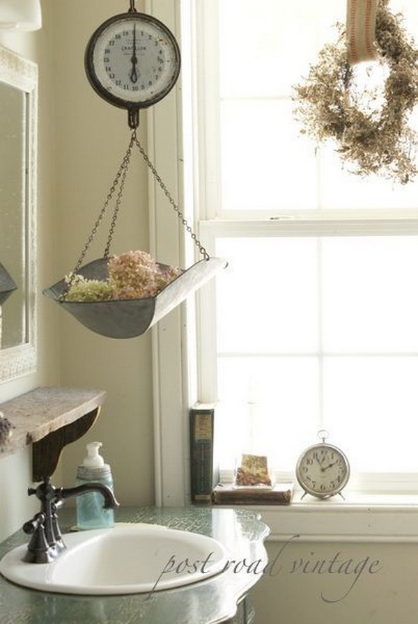 Love the vintage scale holding sea sponges in this farmhouse bathroom. Or you can also use it to store your towels.