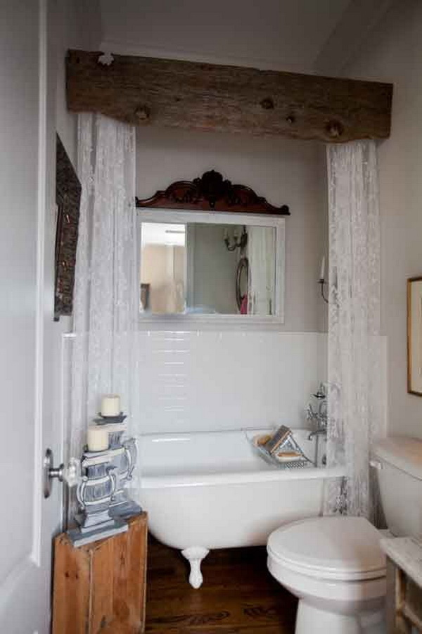 Create a rustic valance for the bathroom using barnwood and white lace.