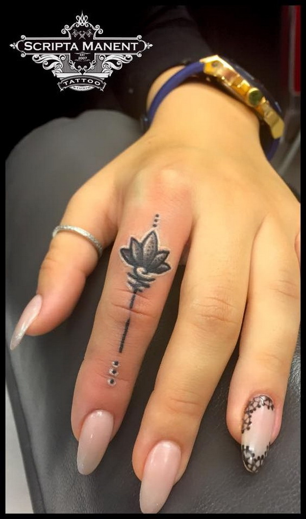 Lotus in Finger Tattoo.