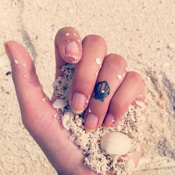 Seashell Tattoo Design on Finger.
