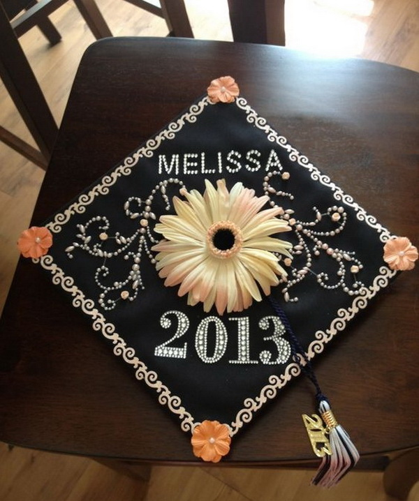 Graduation Cap with a Daisy Flower In Center. 30+ Awesome Graduation Cap Decoration Ideas.