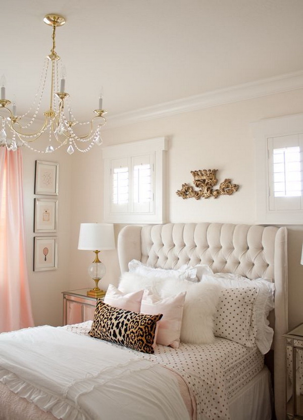 Pink and gold master bedroom with a gorgeous chandelier.