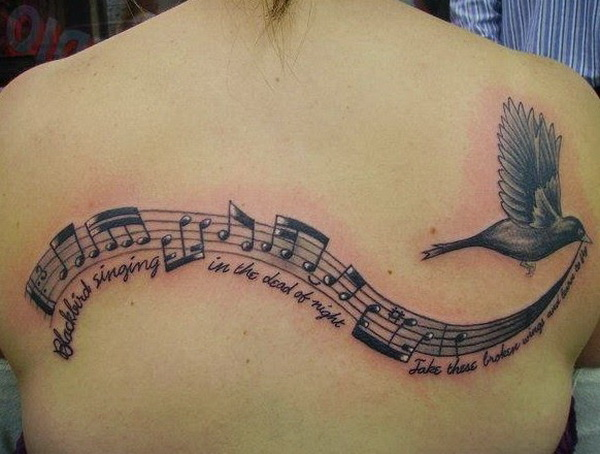 Music Notes and Lyrics with a Bird is Flying Tattoo On Back.