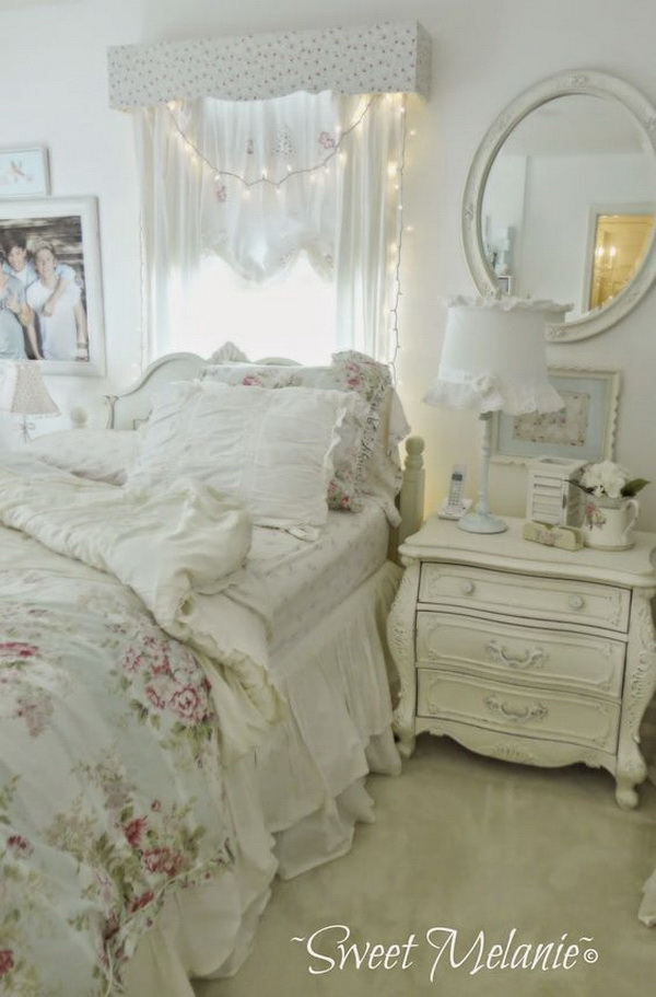 Romantic Shabby Chic Bedroom with Fairy Lights over Headboard and Whitewashed Nightstand.