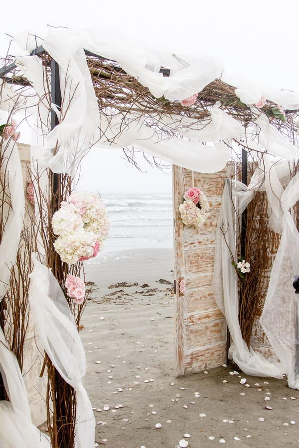 Shabby Chic Beach Wedding Arch with Old Doors and Branches.