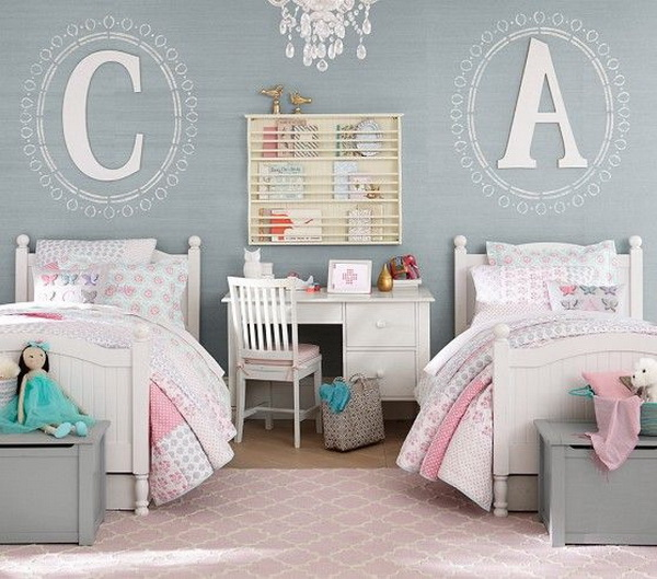 Design ideas for a shared bedroom for girls with gray walls and white beds. Initial above headboard, toy box at the end of each bed.