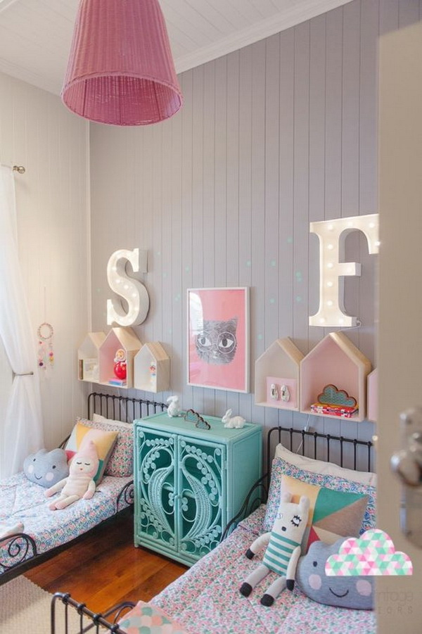 Antique beds and modern furnishings in a child's room for two.