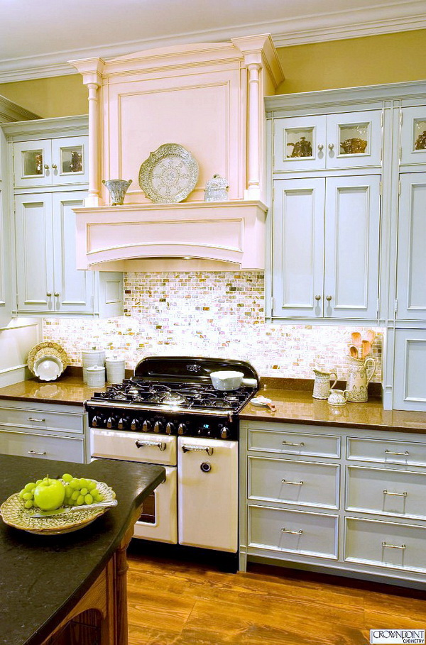 Pale Blue Cabinets Paired with Sparkly Subway Backsplash and a Hint of Pink Fireplace.