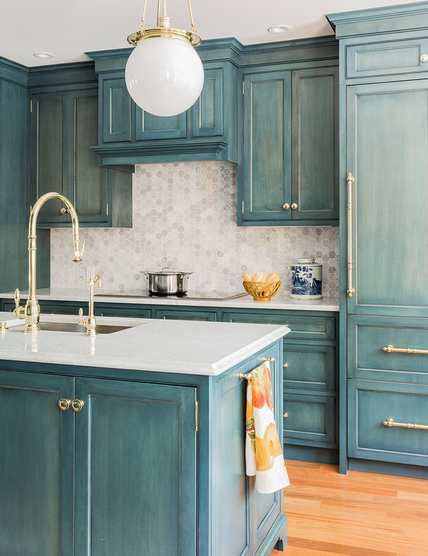 Vintage Blue Painted Cabinets With White Marble Countertop And Hexagonal Backsplash