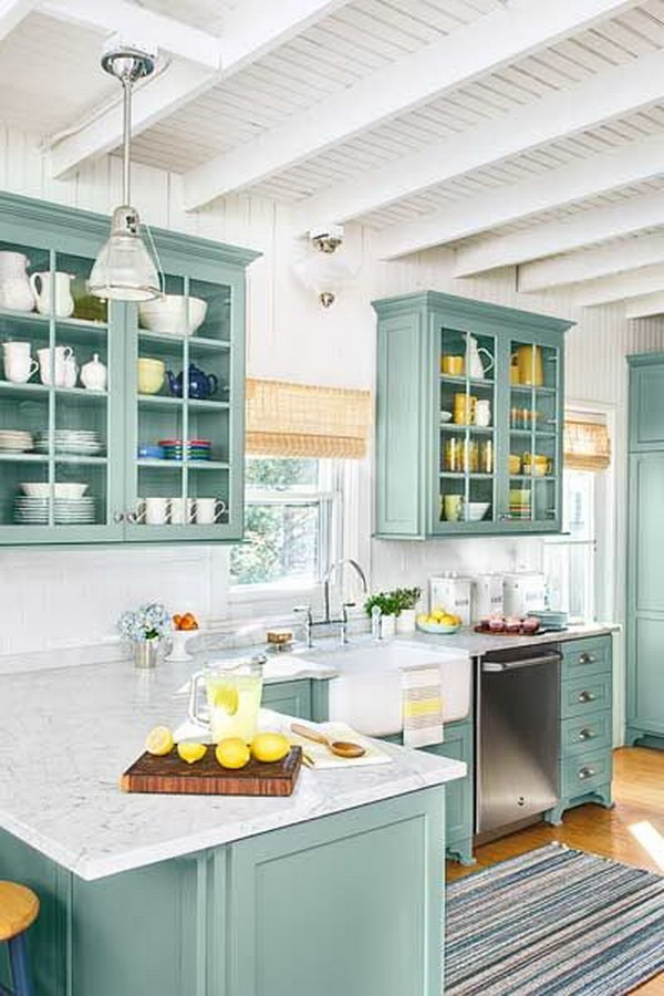 Teal Custom Kitchen Cabinets with Marble Countertops and Subway Tile.