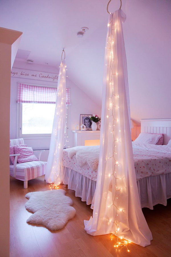 Starry Night String Light for Bed Decor: Simply string up your lights and a couple of sheer draperies from the ceiling. Another creative idea for the lighting in the teen girls' bedroom!
