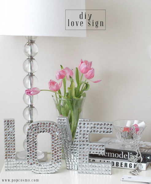 DIY Love Sign. This love sign made with silver sequins and cardboard looks adorable and sweet in the girls' room.