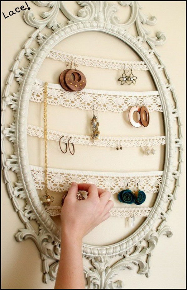 DIY Shabby Chic Jewelry Organizer with Old Frames and Lace.