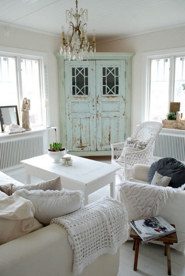 Mint Distressed Cabinet Makes an Accent in All White Shabby Chic Living Room.
