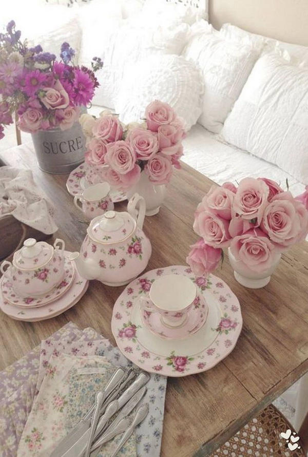 Shabby Chic Living Room Decorating with Fresh Pink Flowers.