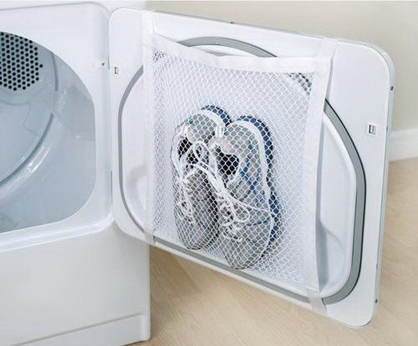 Tape a laundry bag to the inside of your tumble dryer door for easy drying of sport shoes.