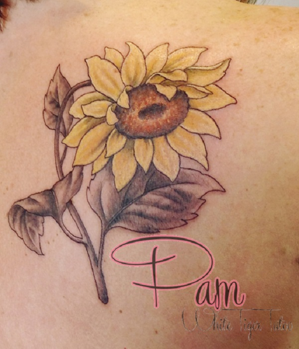 Beautiful Sunflowers Tattooed on the Back.