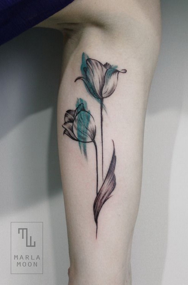 Feminine Watercolor Tulip Tattoo.