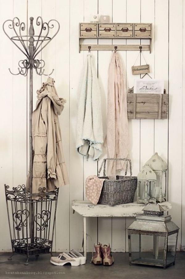 Vintage chic entryway with the rustic coat/ umbrella rack.