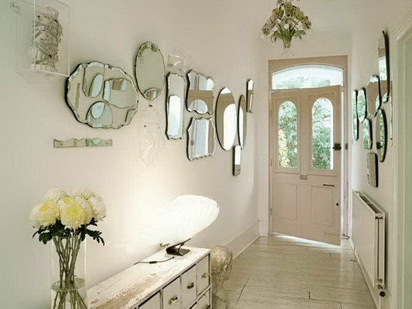 Contemporary Meets Rustic. A collection of vintage style mirrors, the distressed console add interest and an unexpected vintage flair to this entryway.
