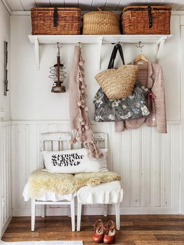 Contry chic looking entryway with aged chairs and shelves.