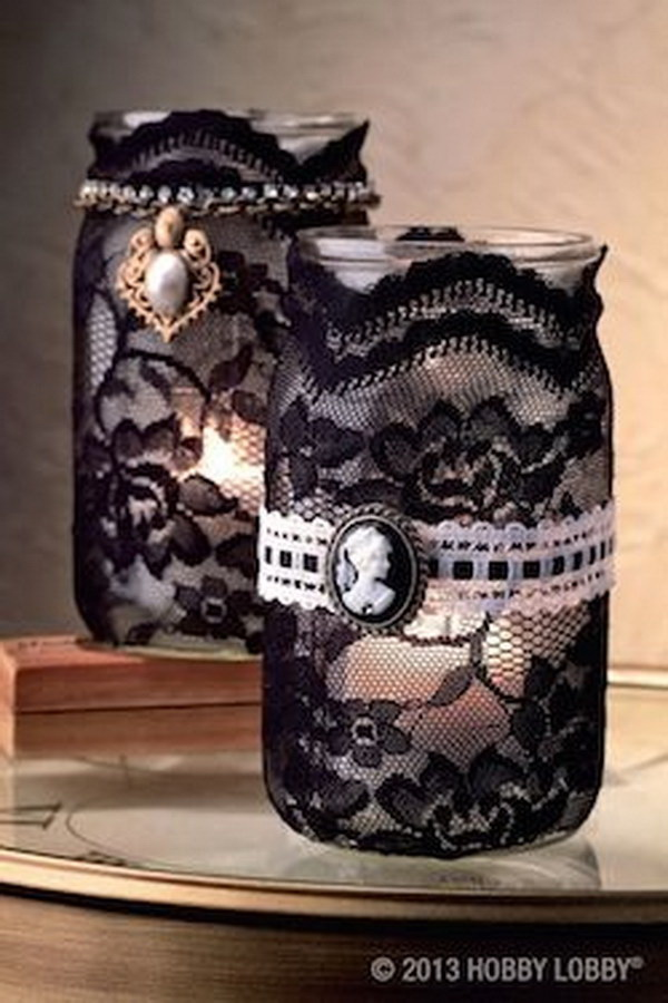 Add more spooky flair to your Halloween decor with these black lace decorated mason jar candle holders.
