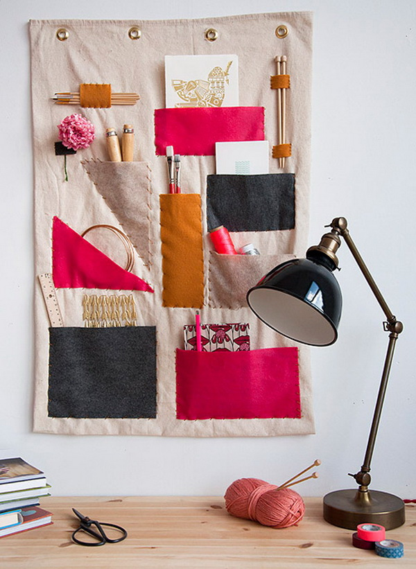 DIY Hanging Scrap Fabric Wall Organizer. Make this functional as well as decorative sewing wall organizer with a duck cloth fabric. It is a great addition to your craft room or home office or kitchen to hold receipes.
