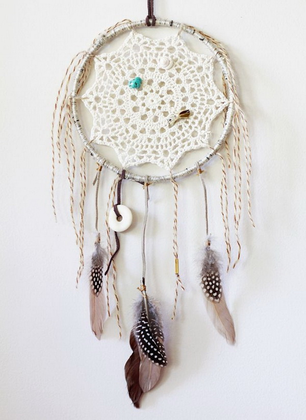 Classic dream catcher that is made with lace and feather. The perfect statement piece for your home.