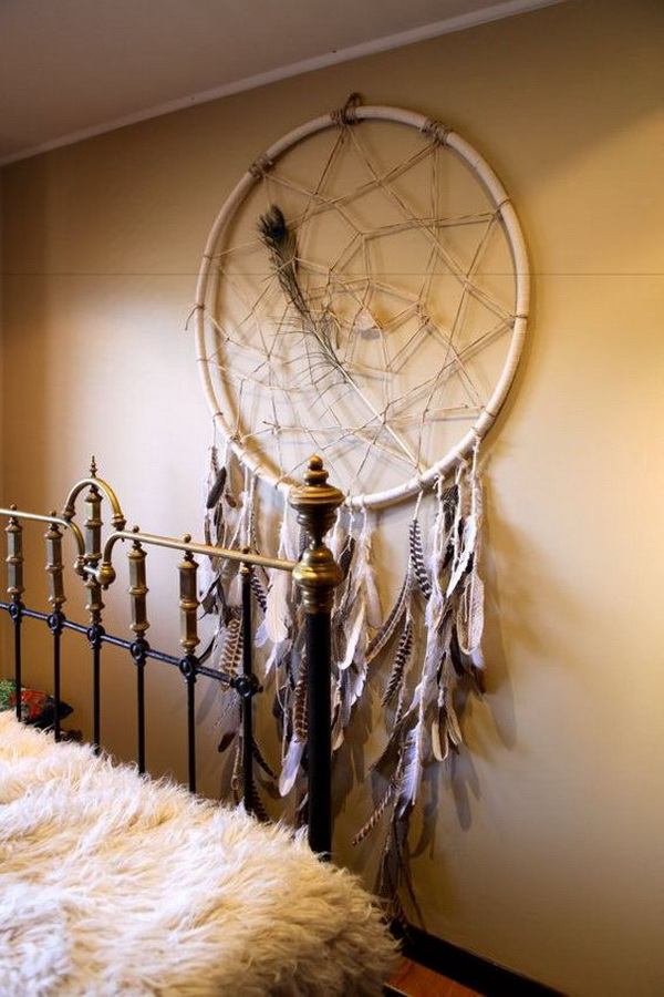 Feather dream catcher. Neutral colors give more modern look and make it the best way for any room decor.