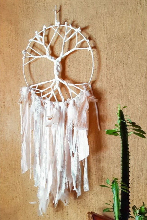 Tree inspired dreamcatcher that is made with T-shirt yarn.